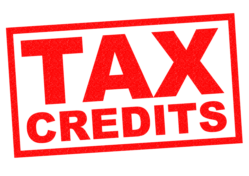 TAX CREDITS red Rubber Stamp over a white background.